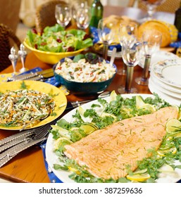 Salmon dinner banquet and salads served on table