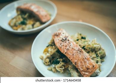 Salmon filet served on pasta