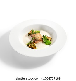 Salmon fillet with baked avocado. Served cuisine. Dish with fish and lemon mousse ingredients in white plate. Luxury culinary. Restaurant food portion, delicious supper, main course