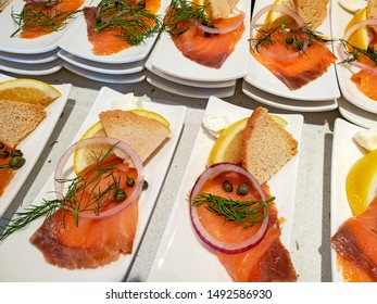 salmon fillet and bread with garnish on white plate for breakfast appetizer