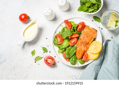 Salmon fillet with fresh salad. Keto diet. Healthy lunch or dinner. top view with copy space.