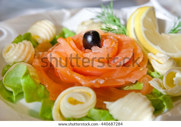 salmon fillet with olive on a plate