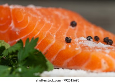 Salmon fillet with salt and peppers.