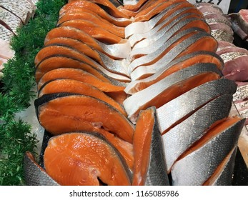 Salmon fillets for sale at a fish market