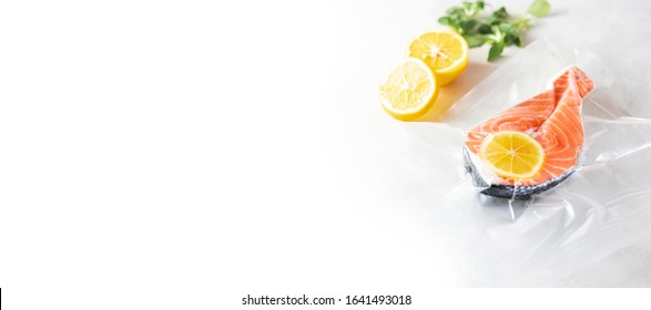 Salmon fillets in a vacuum package. Sous-vide, new technology cuisine. Banner. Selective focus, copy space