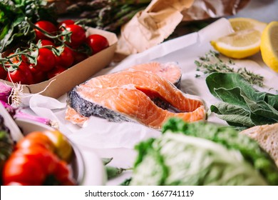 Salmon fish and different vegetables prepared for dinner cooking. Healthy eating concept.