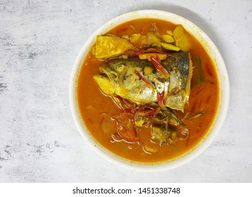 Salmon fish head curry with tomatoes and herbs. top view