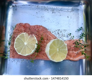 Salmon fish with lemons ready to be put on a grill.