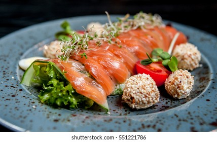 Salmon fish with vegetables on a plate