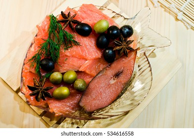 A Salmon fresh and pickled on dish  with olives