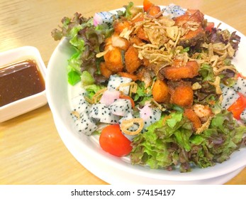 Salmon fried salad with tammarind sauce