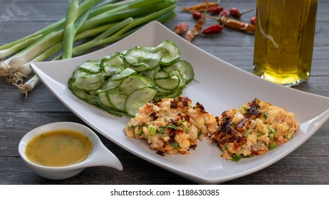 Salmon fritters with cucumber salad