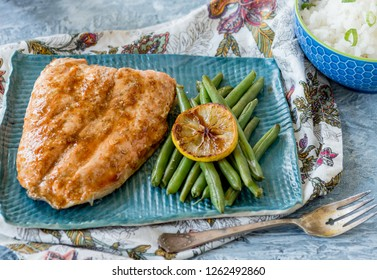 Salmon with green beans and rice on a blue plate
