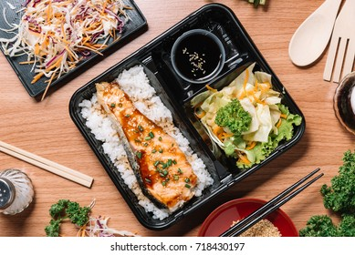 Salmon grilled with rice and vegetable on wooden table, top view , Japanese food concept.