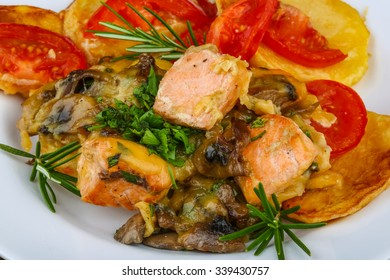 Salmon with grilled vegetables, rosemary and cheese