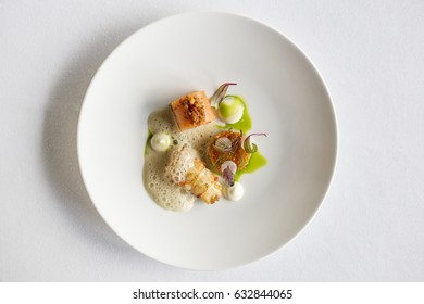 Salmon and haddock dinner plate in a fancy restaurant