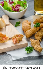 Salmon in herb batter with spicy dressing - fish and chips without fat chips with mixed salad with endive and czech beer