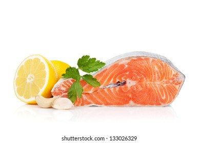 Salmon with herbs and lemon. Isolated on white background