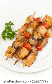 Salmon kebab with tomato and mushrooms