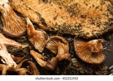 Salmon with mushrooms cooked in the oven