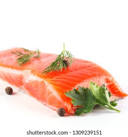 salmon on a white background with herbs and spices. Isolated. Closeup. Square image