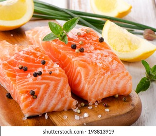 Salmon on a wooden board . Selective focus