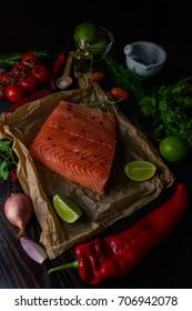 Salmon with paprika, onions, lemons.  Raw cooking ingredints.