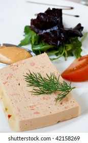 Salmon pate, green salad and sauce