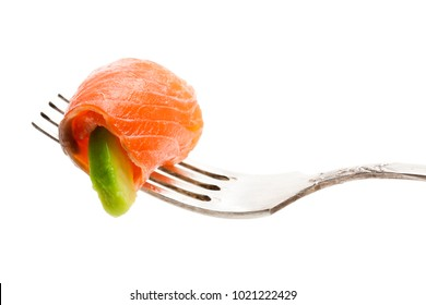 Salmon  piece with avocado on fork isolated on white