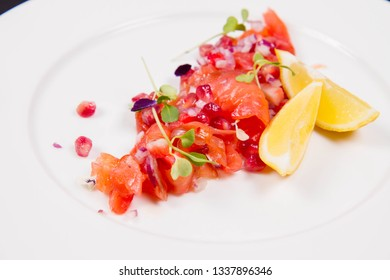 Salmon with pomegranates and onion appetizer