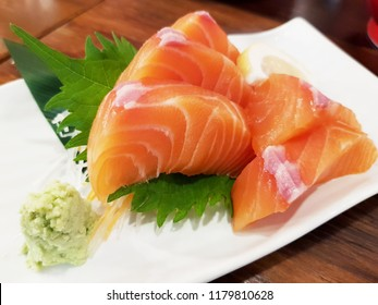 Salmon raw sashimi on brown Japanese traditional dish