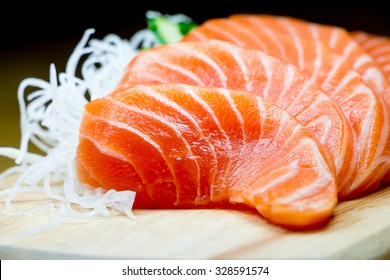 Salmon raw sashimi on wooden table