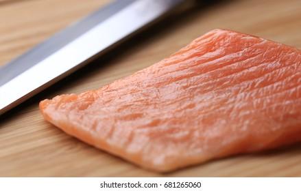 salmon ready to be sliced for nigiri sushi