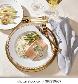 Salmon with rice and asparagus served with endives and white wine