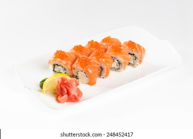 salmon roll with caviar in dish isolated on white