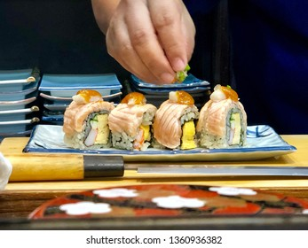 Salmon roll, Sushi salmon roll is Japanese Food fusion. Ingredient are Salmon, Kani, Egg and rice roll topping with cheese, miso sauce and Burn.