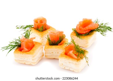 Salmon rolled fillet in pastries isolated on white background.
