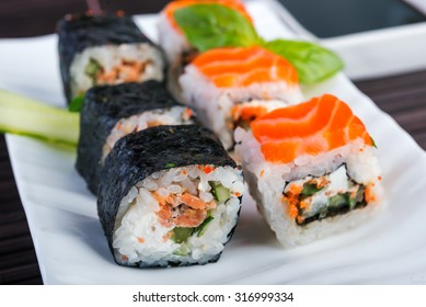 Salmon rolls on white dish. japanese food style.