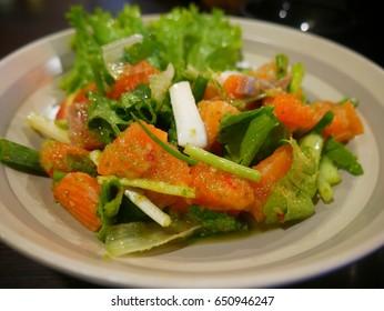 Salmon Salad with Spicy Taste in Japanese Restaurant