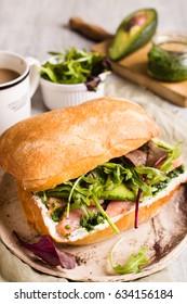 Salmon sandwich with pesto and arugula