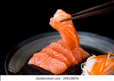 salmon sashimi with black background