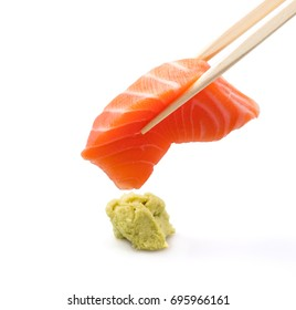 SALMON SASHIMI IN CHOPSTICKS ISOLATED ON WHITE BACKGROUND