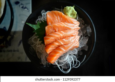Salmon sashimi cutting fresh and raw piece in Japanese food style.