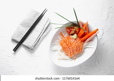 Salmon sashimi and imitation crab stick in Japanese style with kimchi, wasabi.