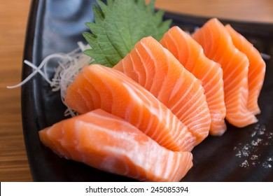 Salmon Sashimi on Black Ceramic Plate