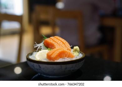 Salmon sashimi - Raw fresh salmon sliced served on ice with wasabi, Japanese food style.
