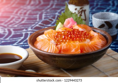 Salmon sashimi and salmon roe with rice bowl or donburi in Japanese style food.