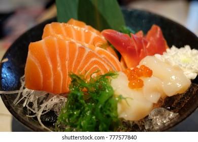 Salmon sashimi with seaweed and caviar, japanese food,