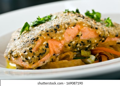 salmon with sesame crust on vegetables