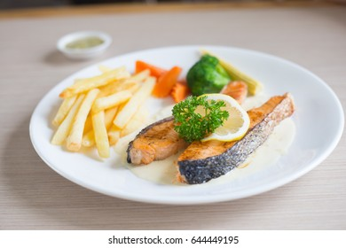 Salmon slice steak with yellow lemon decorated and vegetable, Fish &  chip